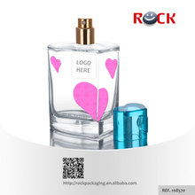 Personalized design 100ml pink heart shaped with blue plastic cap perfume bottle