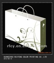 2014 printing factory supply art paper printed gift bag with ribbon bow and cotton rope