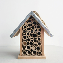 Wooden insect house with iron roof