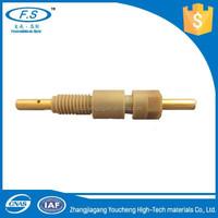 High performance peek molded over brass