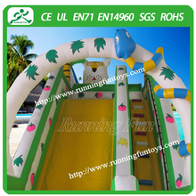 Jungle-themed inflatable slide with tiger/snake