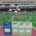 líquido transparente de resina epoxi y endurecedor para deportes piso