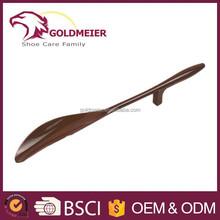 Brown plastic shoe horn long handled