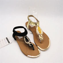 Design new trend top fashionable metal decorations for girls sandal