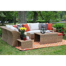 rattan furniture hide-away stools and orange bright color toss pillows living room sofa set