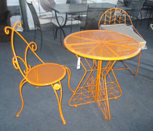 steel metal mesh side chair with round dining table