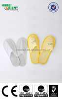 Disposable nonwoven slippers for indoor use