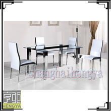 glass top with stainless stell tube dining table