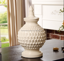white ceramic ornaments with top on