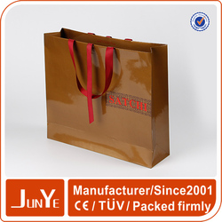 Paper craft shopping bag with ribbon handle