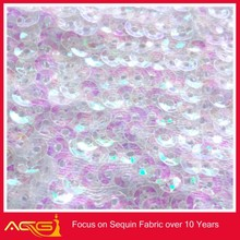 The hot sale top 100 design 100% polyester beautiful fair fascinating romantic sequin fabric loose beads material sequin oval