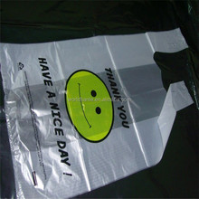 """Clear gusseted plastic T shirt bags with """"smile"""" printing for shopping use, thank you t-shirt carrier bags"""