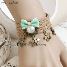 SL-131 Yiwu Caddy Vintage chic style artificial pearl flowers hemp rope bracelet