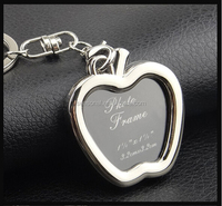 Wholesale and OEM zinc alloy new design apple shaped photo frame key chain for lover gift