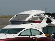 Toma retrofit flybridge top and motorized windshield available for used boats for sale japan