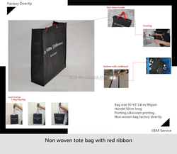 Non woven shopping/gift tote bag with red ribbon handle