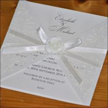 laser cut wedding invitation with ceramic rose decoration