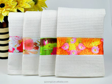 transfer-printed waffle cotton tea towel with flower design