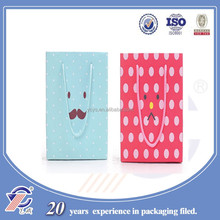 2015 fancy design cute facial expression printed gift paper package bag OEM are accepted