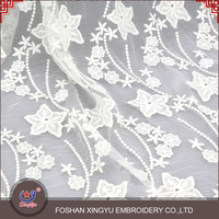 Hot-selling promotional new style embroidery net dress materials white lace mesh fabric for clothing