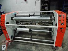 Plastic film mother rolls slitting and rewinding machinery