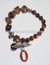Metal wing pendant bracelet jewelry with brown acrylic beads