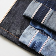 Using old-fashioned shuttle 100% cotton selvedge denim fabric.