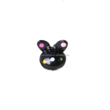 Cute kids fancy black with colorful dot pattern hair claw for human wear.