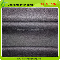 Water soluble interlining elastic adhesive backed heavy weight woven interfacing