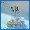 glass vinegar and oil cruet with metal rack