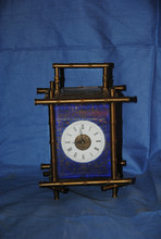 traditional mantel clock on fireplace