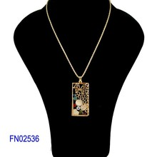 Gold plated square pendant necklace with butterfly, clover, rhinestones charms
