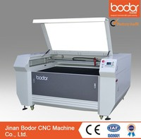 acrylic/ wood/ leather/ fabric/ plastic co2 laser cutting balsa wood machine