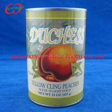 Canned yellow peach halves fruit in syrup