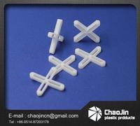 plastic ground tile cross