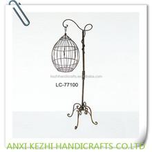 antique decorative metal bird carrier