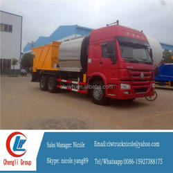 Chip sealer road construction truck
