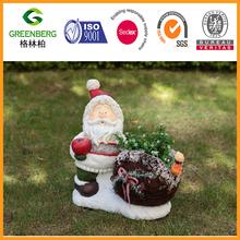 Christmas Santa statue holding apple with rattan flower pot for garden decoration