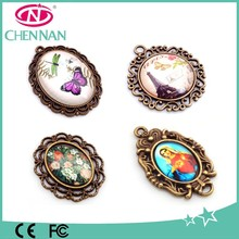 Wholesale antique style charms , glass cabochon with metal frame pendants & charms