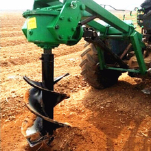 mini tractor earth auger / post hole digger