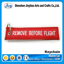 hot sale high quality embroidery textile fabric keychain with remove before flight design