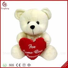 Hot selling plush beige teddy bear with a heart stuffed bear dolls soft cartoon animal toys