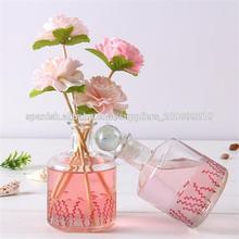 botella de cristal aroma difusor de lámina con flores sola