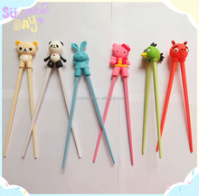 children learning chopsticks with silicone helper
