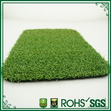 green fake plastic lawn with natural looking