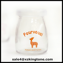 Yellow decal glass pudding jar with wooden and plastic lid