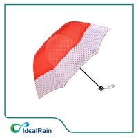 bright orange color dotty printed doom shape beautiful lady's umbrella