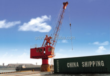 Seaport swing portal jib crane with container spreader or grab