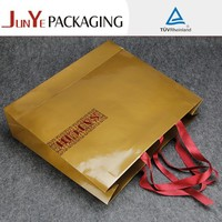 Low price cardboard custom logo 250 gsm recycled fancy large brown paper bags