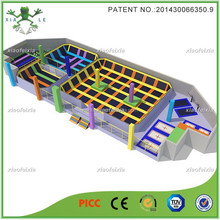 outdoor trampoline park with enclosure ,basketball hoops inside
